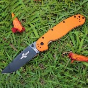 Ontario Rat 1 оранжевая рукоять черный клинок